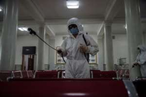 'Anti epidemic officials' were seen spraying disinfectant at Pyongyang Railway Station.  By KIM Won Jin (AFP)
