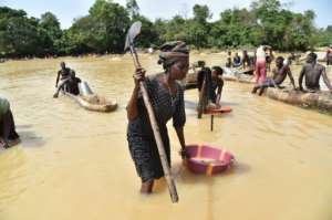 Gold prospectors work in northern Sierra Leone, one of the world's poorest countries