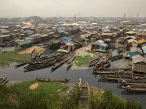 Lagos' population has muchroomed, as have the shanty towns.  By FLORIAN PLAUCHEUR (AFP)
