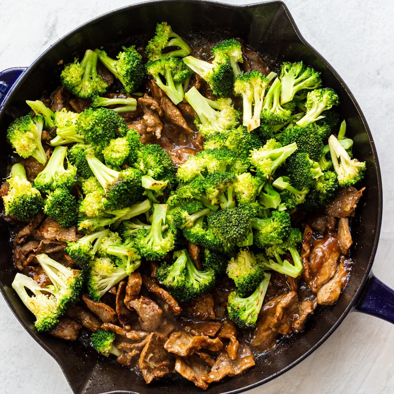 pan with beef and fresh broccoli just added