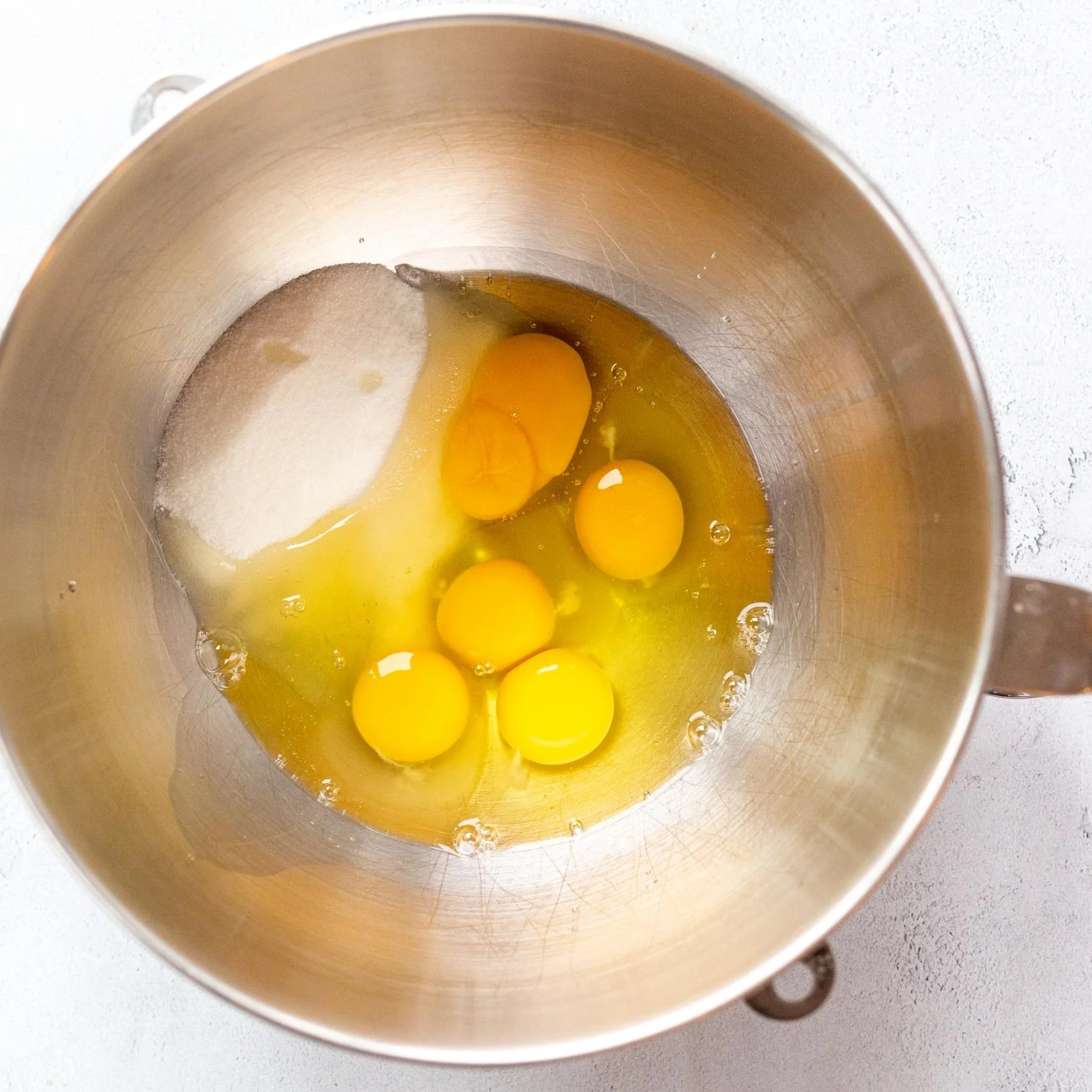 eggs and sugar in a mixing bowl