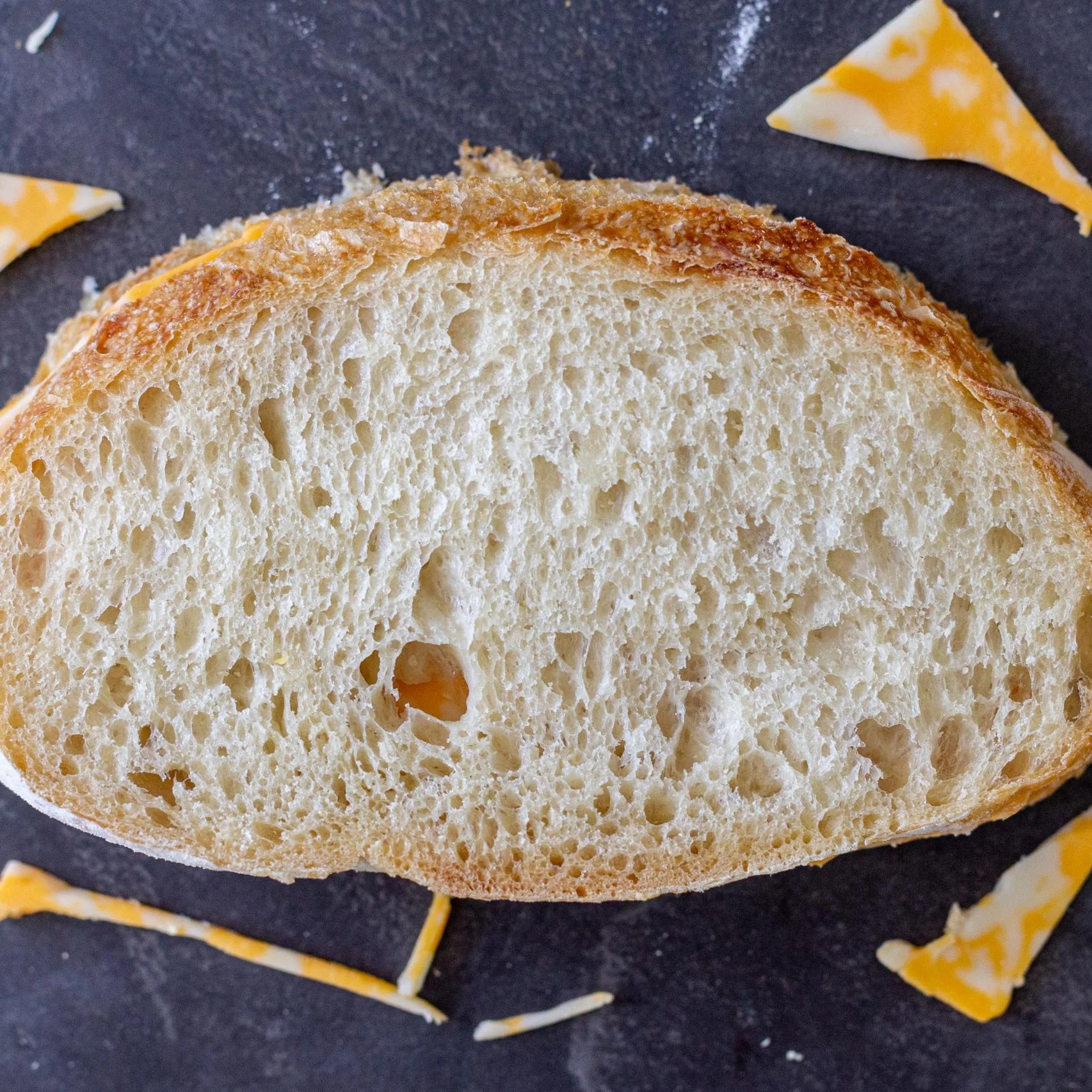 bread with pieces of cheese cut off