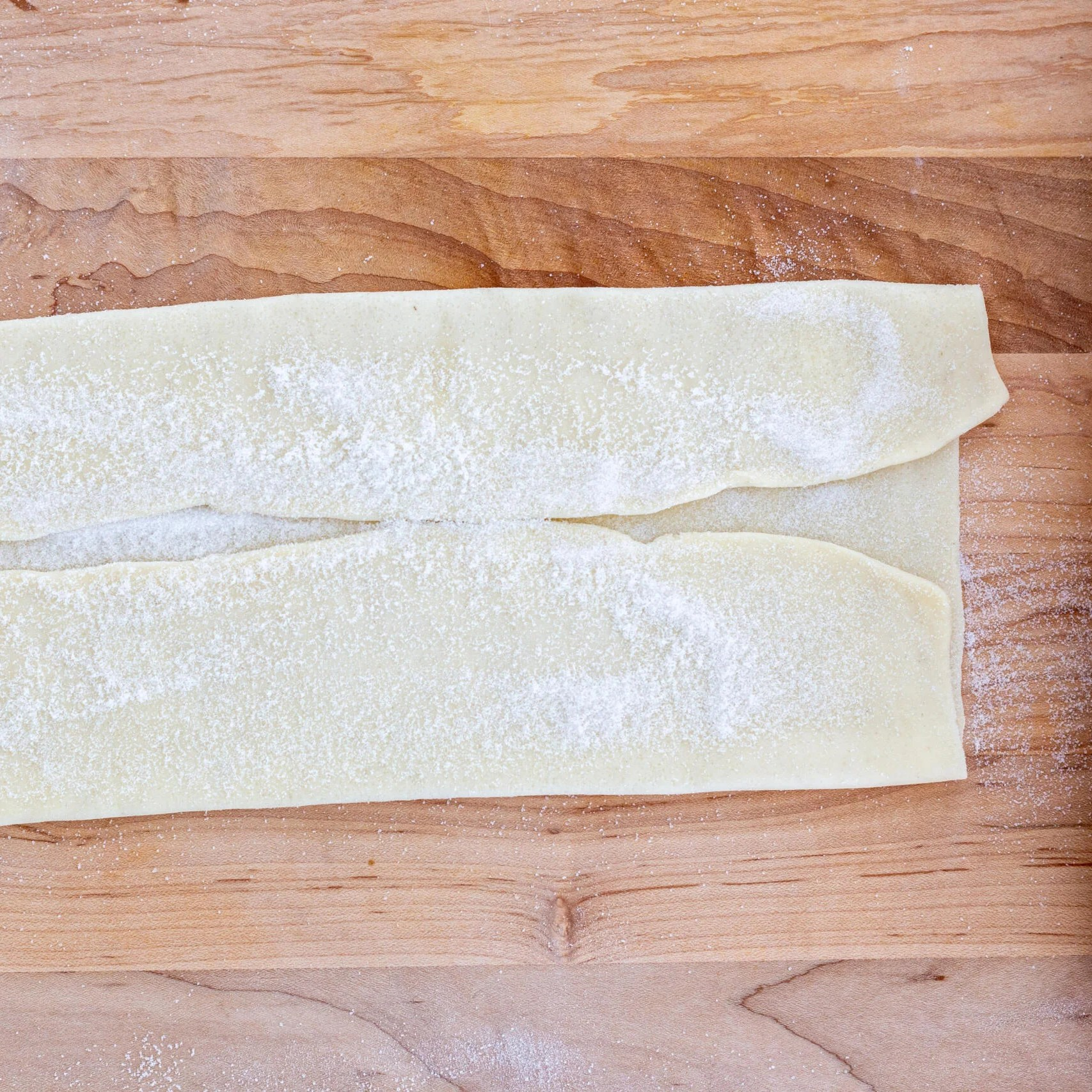 folded puff pastry with sugar