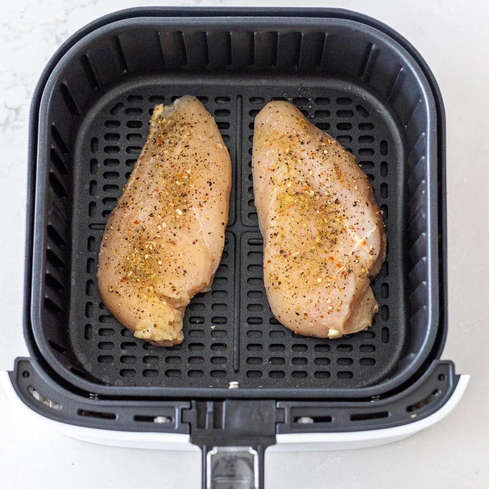 Chicken breast in an air fryer basket