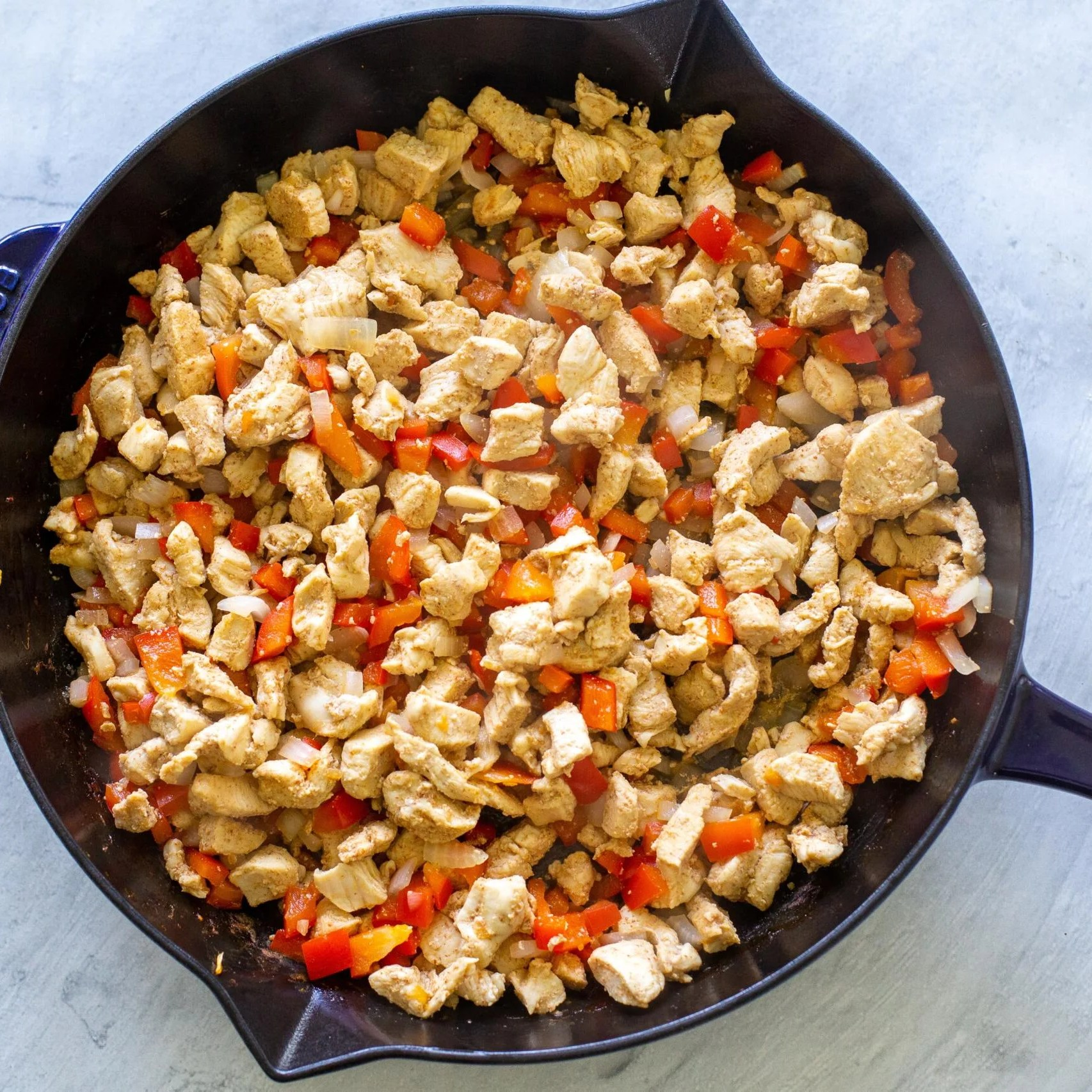 cooked chicken, bell peppers and onion
