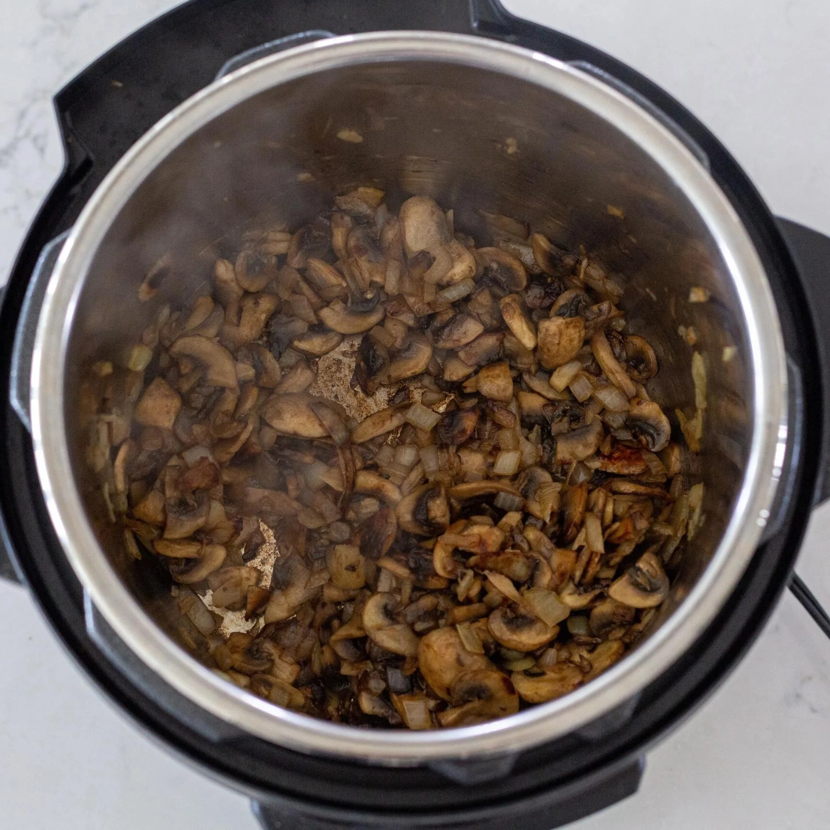 Mushrooms cooking in an inst