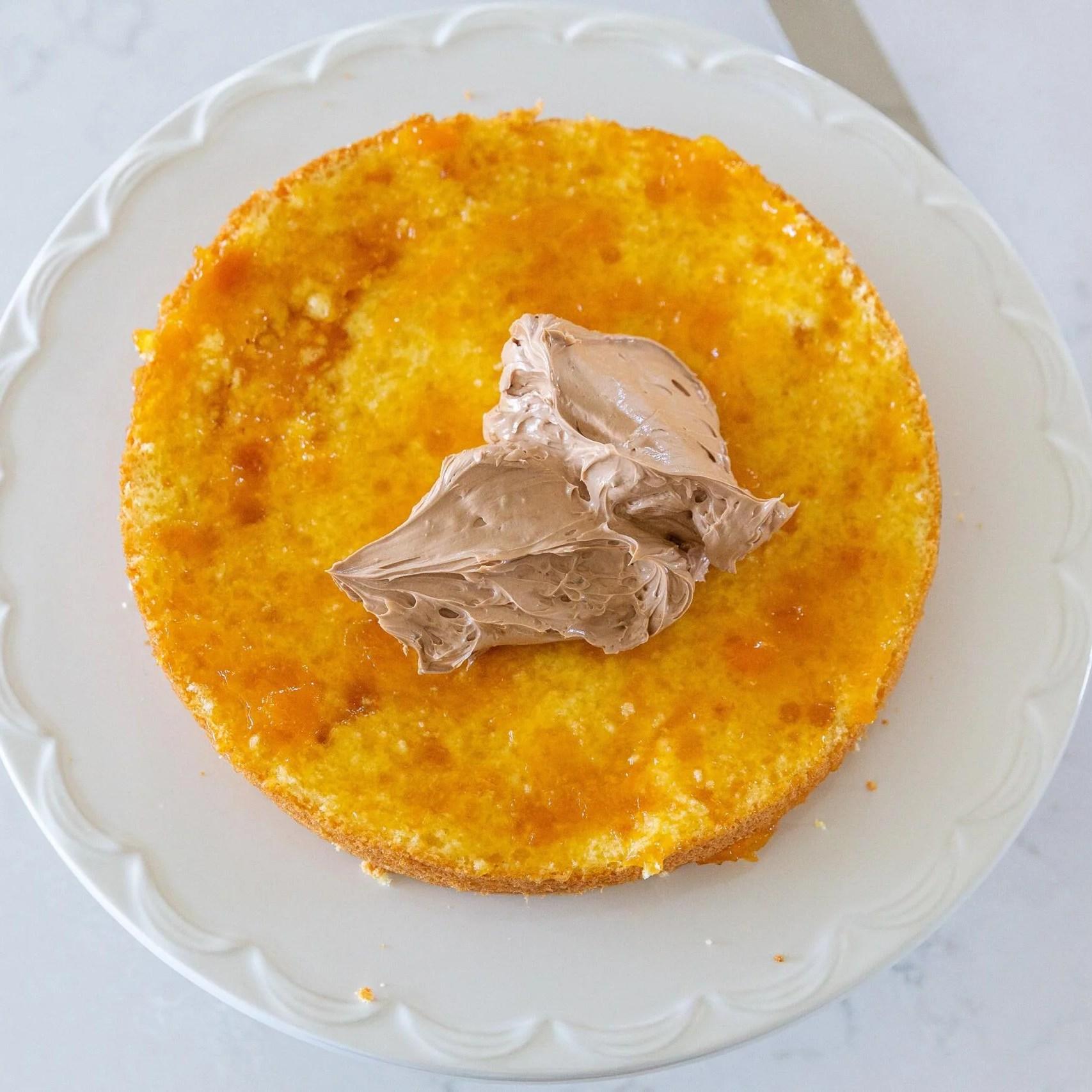 Cream added to the sponge cake with jam