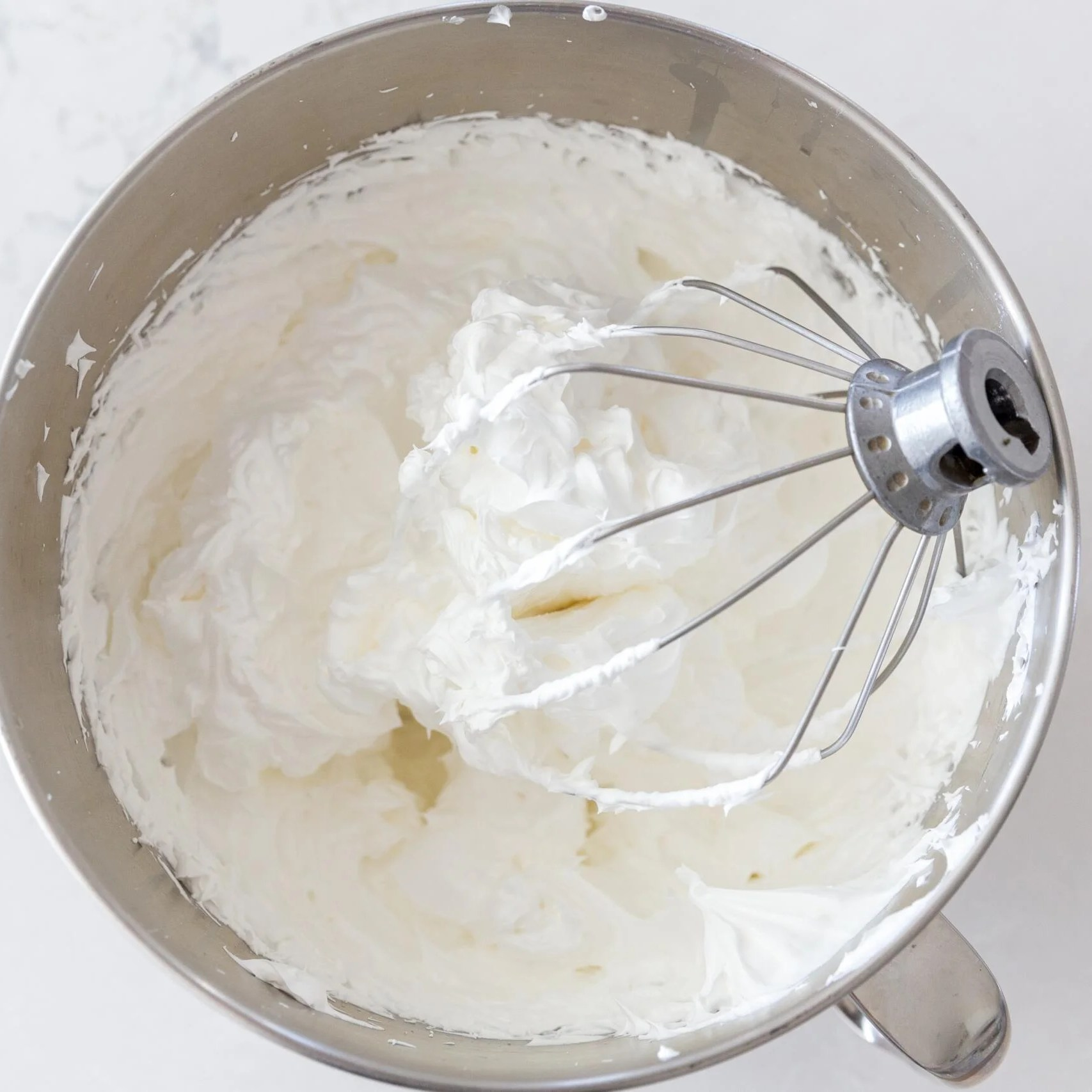 Whisked egg whites in a mixing bowl