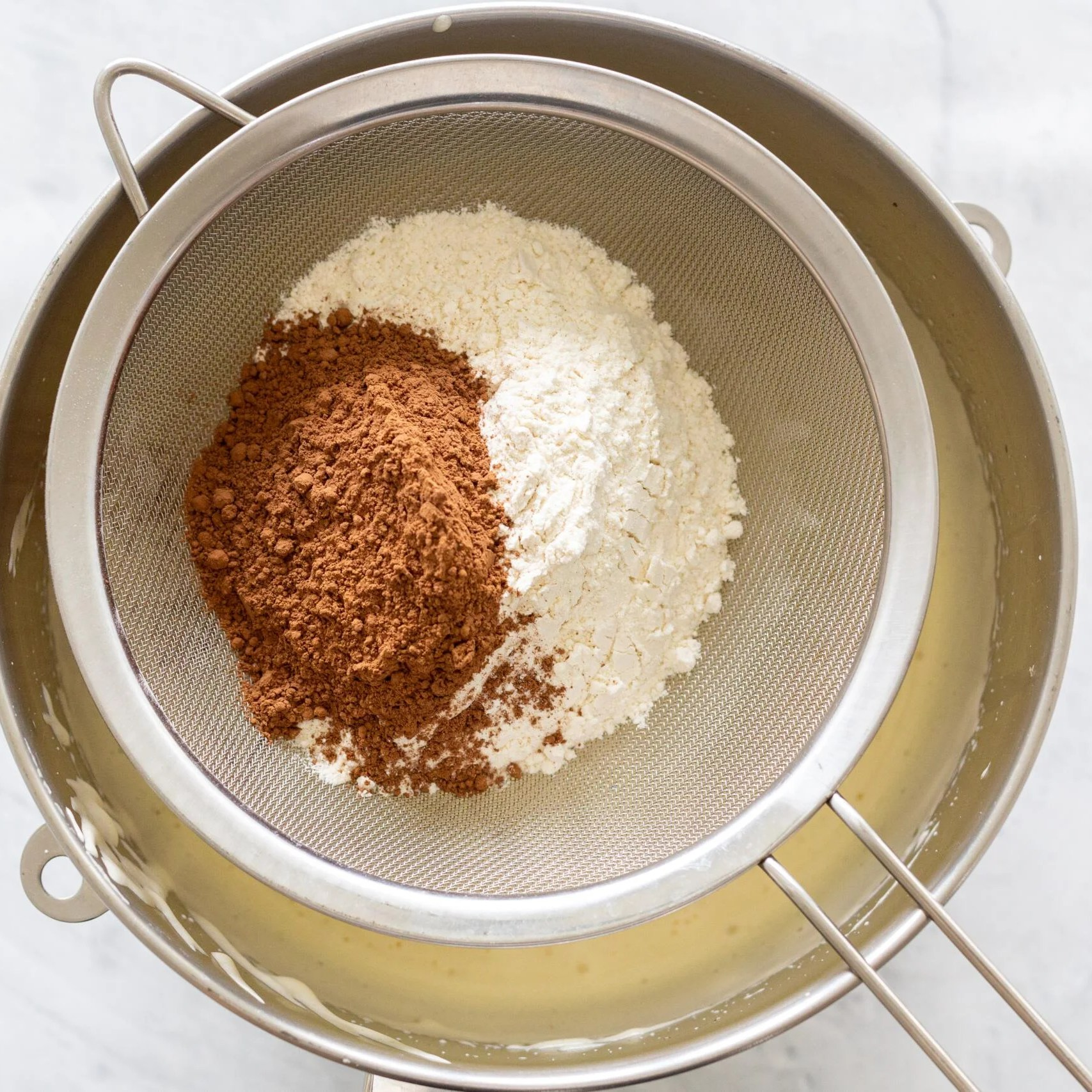 flour and cocoa in a sifter