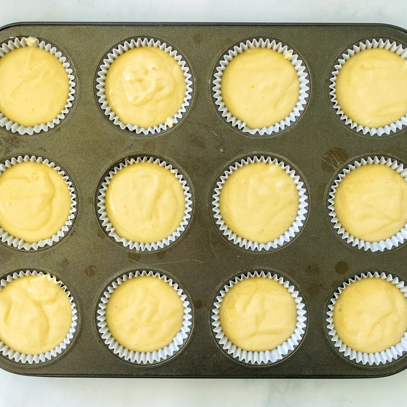 cupcake mixture in molds