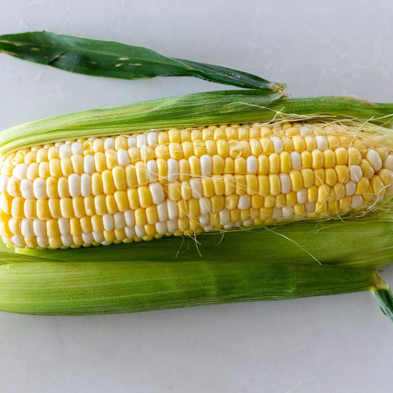 corn halfway peeled