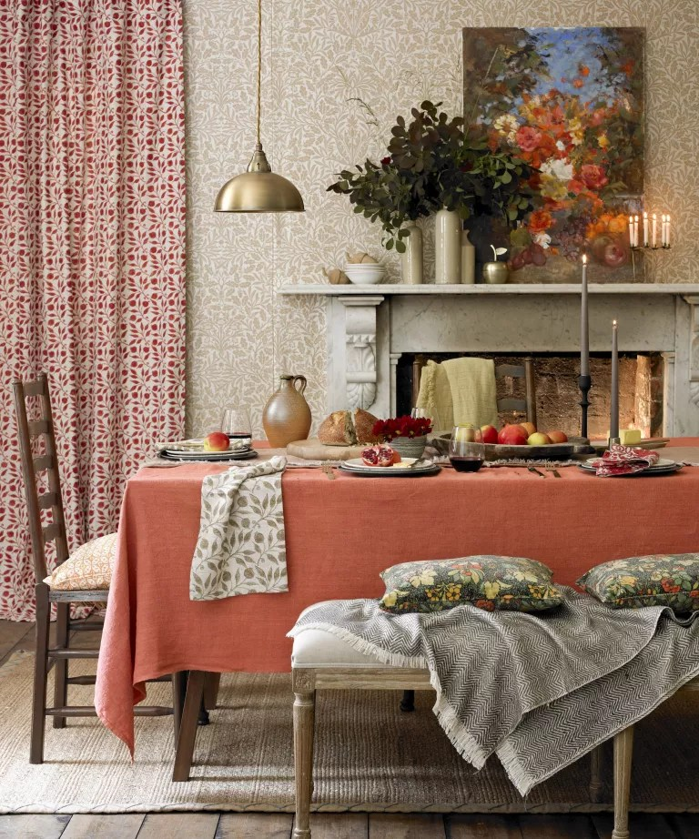 Fall mantel ideas with a marble mantelpiece, wooden and golden ornaments and orange and blue autumnal painting