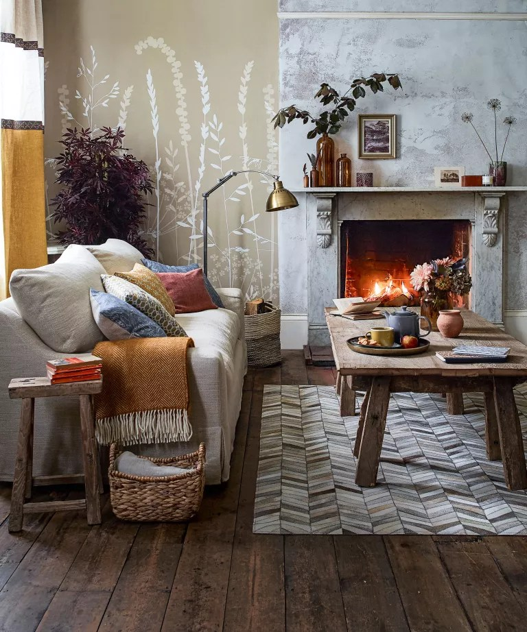 Living room fall decor with fireplace and wood floor