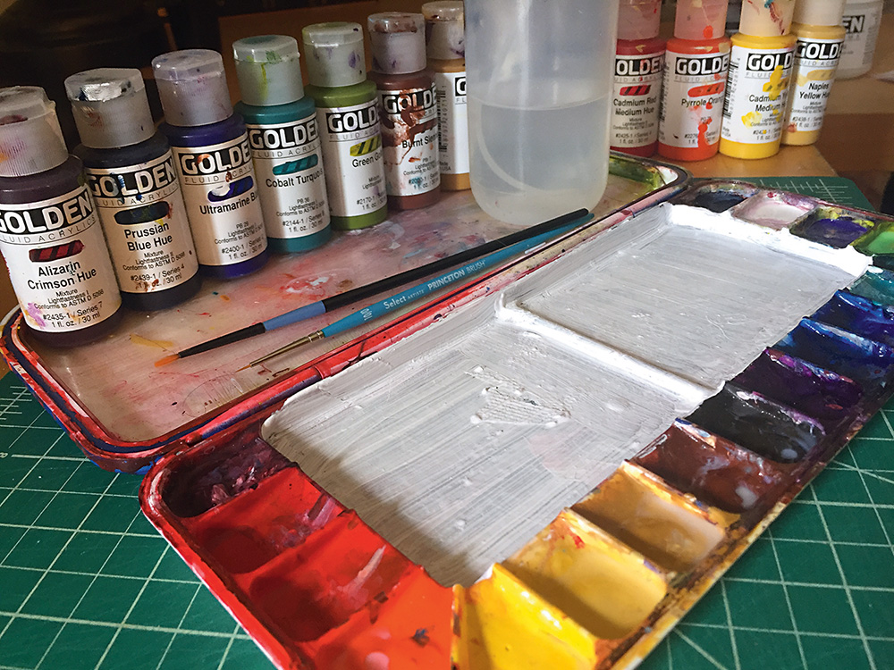 Acrylic paints and paint brushes