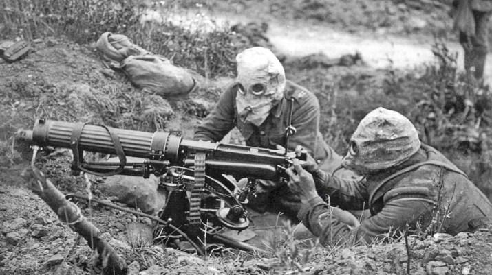 Image of soldiers in gas masks manning a machine gun