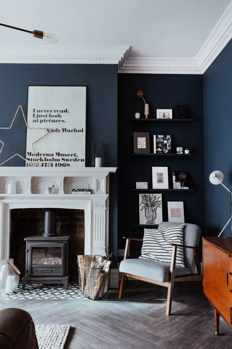 Blue living room with white fireplace