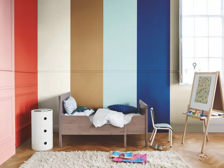 kids bedroom with rainbow painted wall by dulux