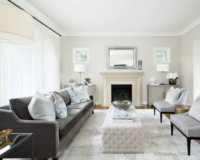 A living room curtain idea with white walls and pale neutral curtains