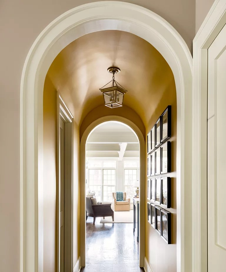 Hallway with tall arched ceiling