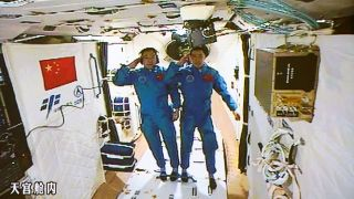 Two Chinese astronauts as seen on the space station Tiangong-2 on Oct. 19, 2016.