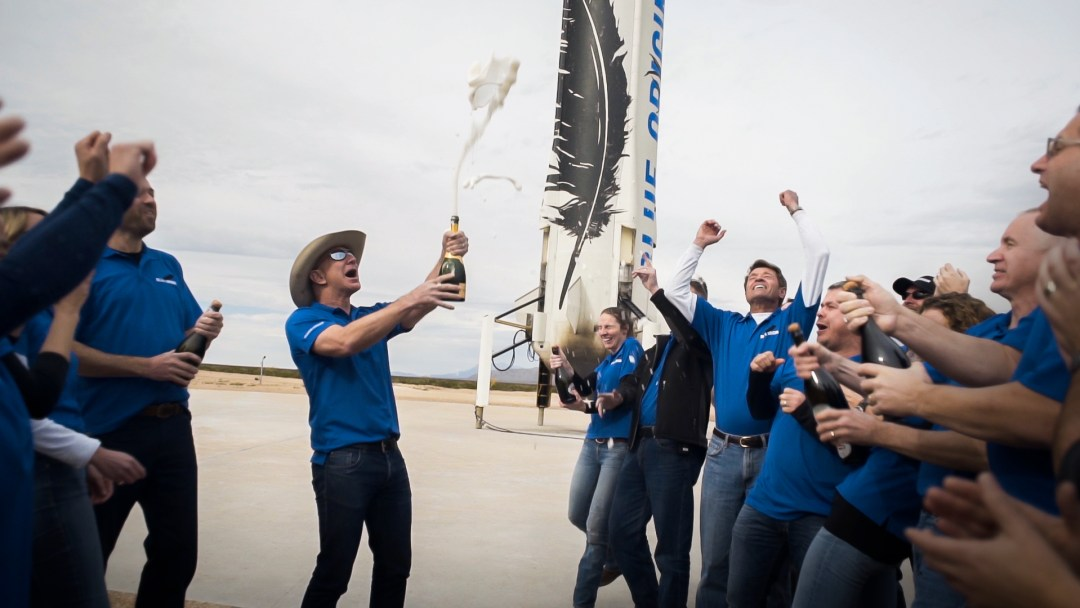 Jeff Bezos and Blue Origin staff celebrate the successful landing of a New Shepard rocket.