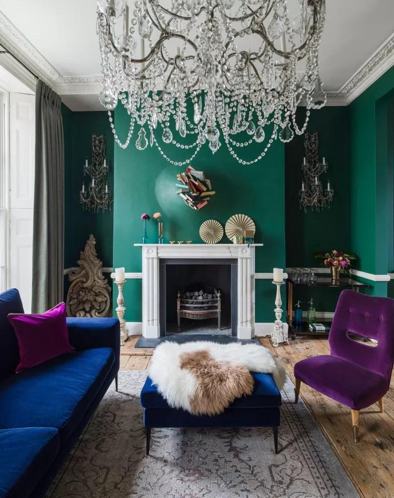 Dark green living room with blue and purple velvet furniture