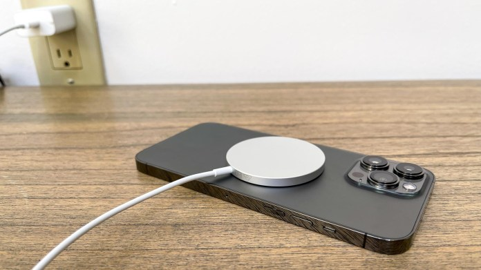 iPhone 13 Pro Max charging on table