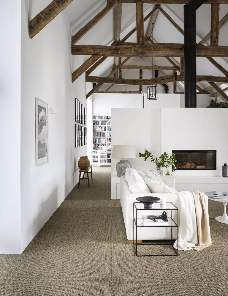 Rustic living room with fitted sisal carpet