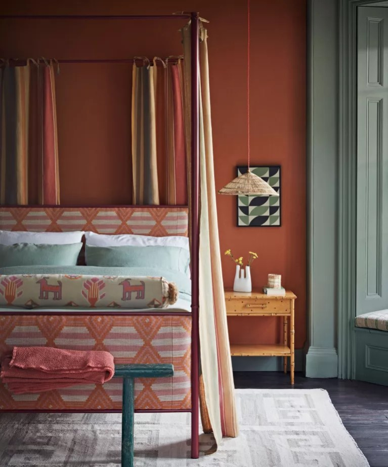 Bedroom ideas: warm colourful bedroom with four poster bed