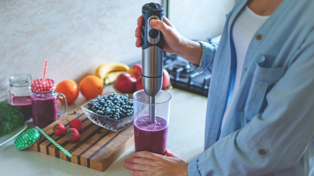 immersion blender being used in a kitchen to blitz fruit