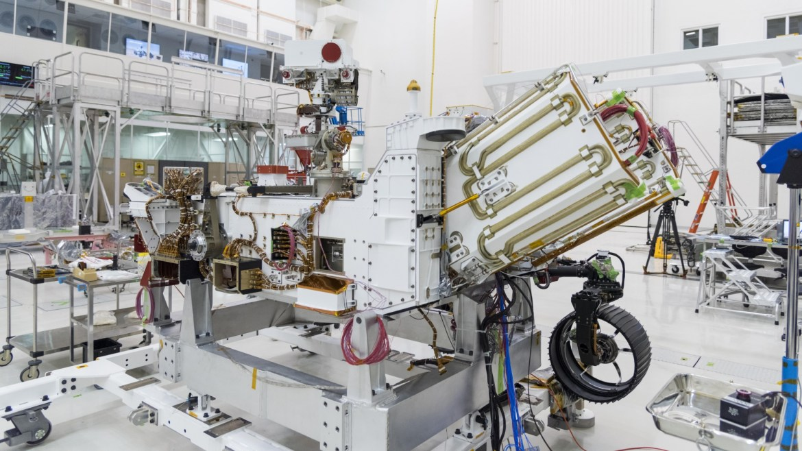 The Mars 2020 rover's power system, called a Multi-Mission Radioisotope Thermoelectric Generator (MMRTG), will be inserted into the aft end of the rover between the white panels with gold tubing.