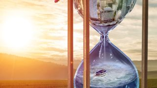 hourglass with scene in it and sunset