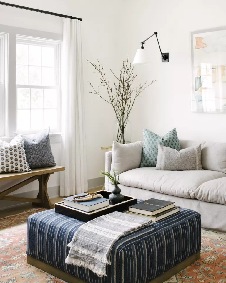 white living room with sheer curtains