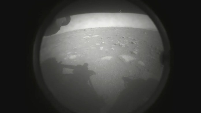 This is the first photo NASA's Perseverance rover beamed back to Earth after it landed on Mars on Feb. 18, 2021.