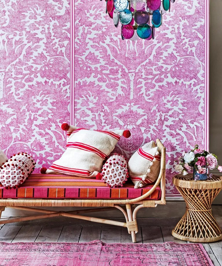 Bohemian bedroom ideas with pink wall, pattern and rattan