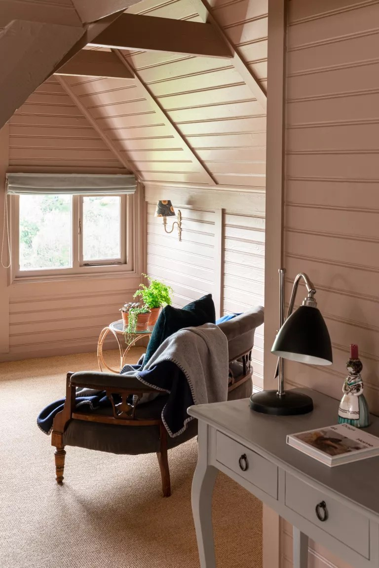 pink bedroom with pink painted shiplap walls and ceiling
