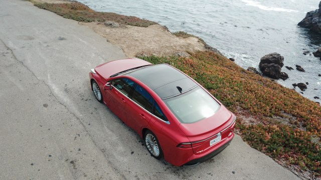 Top-down view of the Toyota Mirai (2021) parked on a coastal road