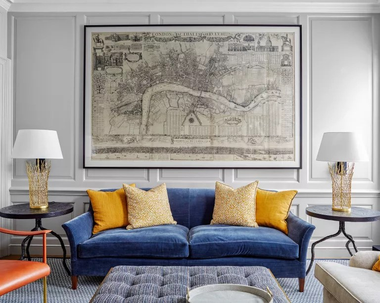 Simple living room with blue sofa and yellow cushions
