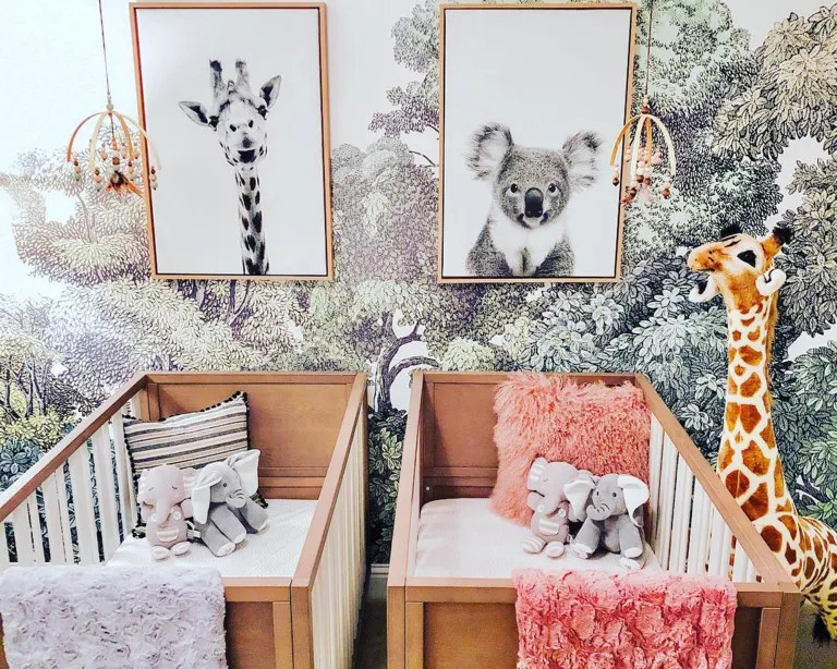Twin nursery idea with floral wallpaper and framed wall art by Karlee Zacky