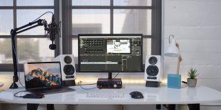 Blue Blackout Spark SL in front of desktop and speakers