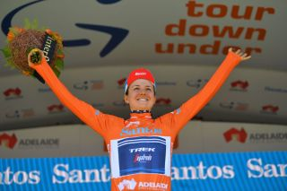 US champion holds off attacks from Lippert and Spratt. Frapporti wins final stage sprint