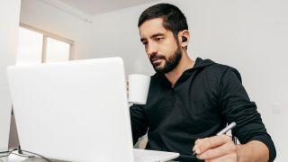 Man using free screen recorder on laptop
