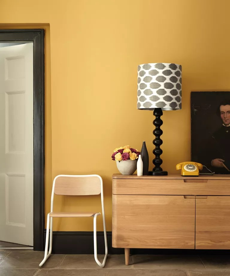 Yellow living room with sideboard