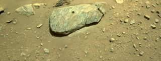 """This composite of two images shows the hole drilled by NASA's Perseverance rover into a rock dubbed """"Rochette"""" during its second sample-collection attempt. The photos were obtained by one of the rover's navigation cameras on Sept. 1, 2021."""