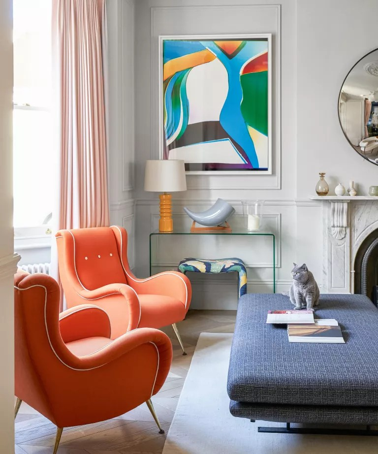 Living room with orange chairs and low furniture