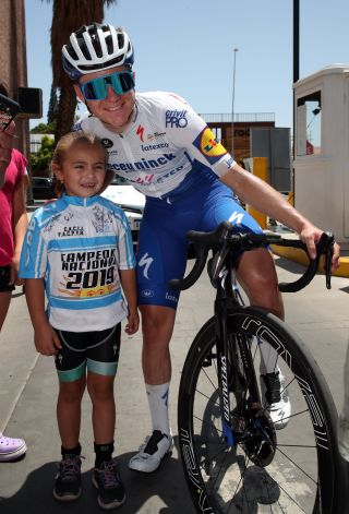 Remco Evenepoel and a young fan