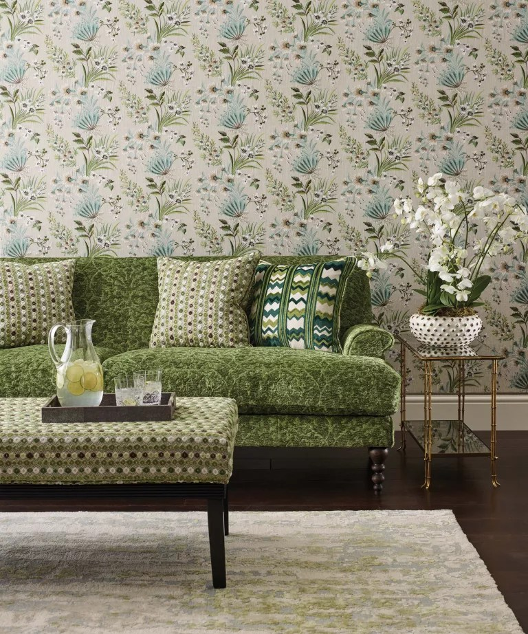 Nina Campbell's green home decor tips, green wallpaper and chair in living room