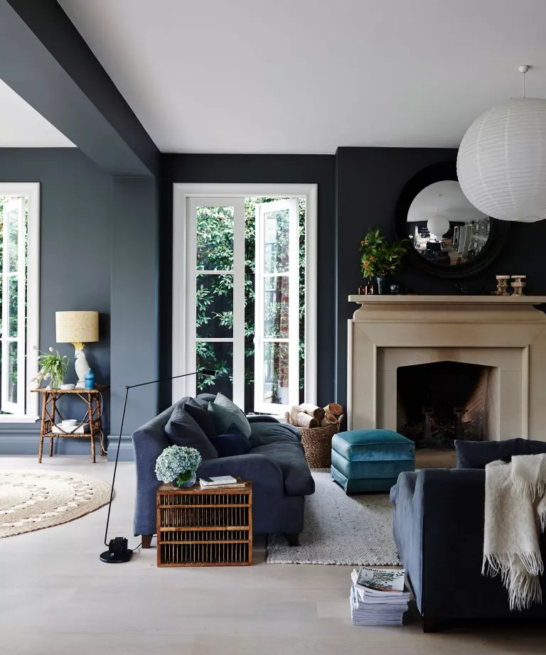 Living room fall decor with stone fireplace