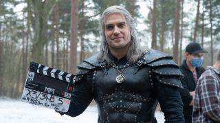 Henry Cavill behind the scenes of The Witcher, one of the best Netflix shows in our list.