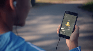 person playing pokemon go outdoors